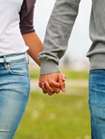 couple-holding-hands-151x200
